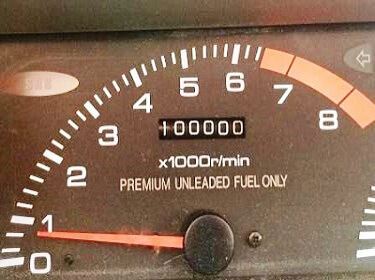 odometer showing 100k miles