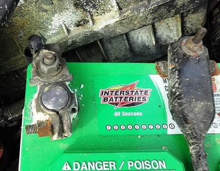 corroded positive battery terminal